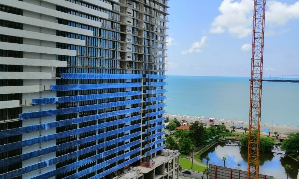 "We offer apartments in Orbi Twin Tower, Batumi, Tower ""A"", a view of the pool and the sea,"